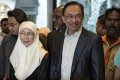 Malaysian opposition leader Anwar Ibrahim (centre) and his wife, Wan Azizah, arrive at the Court of Appeal in Putrajaya, outside Kuala Lumpur. Photo: AFP