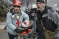 Activists evacuate a wounded protester during clashes in Kiev. There are now questions about who was behind sniping attacks in the city. Photo: AP