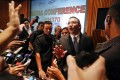 Malaysian transport minister Hishammuddin bin Tun Hussein is bombarded with questions at yesterday's news conference. Photo: Reuters