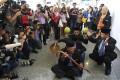 Ibrahim Mat Zin, also known as the Raja Bomoh Sedunia Nujum VIP, used spiritual methods and prayers at the Kuala Lumpur International Airport to help locate the missing plane. Photo: Reuters