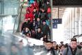 Passengers baord trains at Yinchuan station, Ningxia. Photo: Xinhua
