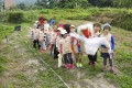 Making a scarecrow to protect seed beds is part of the hands-on fun for children at Dragontail Farm near Mui Wo.