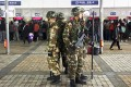 Armed paramilitary policemen stand guard next to ticket booths after at Kunming railway station. Photo: Reuters
