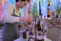 """An MGM Macau staff member grinds """"elephant dung"""" coffee beans by hand before serving up the rarefied brew. Photo: Lana Lam"""