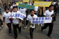 Chinese relatives of passengers on missing Malaysia Airlines flight MH370 march to protest outside the Malaysian embassy in Beijing. Photo: AFP