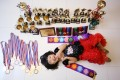 Dance prodigy Pearl Chan Pui-yee with her trophies. She will soon take an exam to become an assistant dance teacher. Photo: Sam Tsang