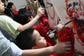 Children paint to the beat of music at the Children's Institute in Kennedy Town. Photo: K. Y. Cheng