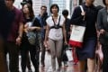 Post reporter Ada Lee (centre) walks from her home in Taikoo Shing to the office in Causeway Bay. Photo: Nora Tam