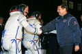 Russian Federal Space Agency Roscosmos head Oleg Ostapenko (right) shake hands with US astronaut Steven, a crew member of a mission to the International Space Station. Photo: AFP