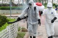 Staffs from Food and Environmental Hygiene Department use aerosol to kill mosquitos in the area around Tin Hang Estate in Tin Shui Wai, after a man was diagnosed to have been infected with Japanese Encephalitis. Photo: K. Y. Cheng