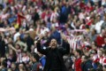 Simeone gestures towards Atletico fans during his team's match against Villarreal at the Vicente Calderon  on Saturday. Photo: AP