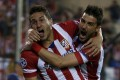 Koke celebrates his goal with David Villa. Photo: Reuters