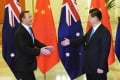 Chinese President Xi Jinping (right) extends his hand to greet Australian Prime Minister Tony Abbott before a meeting at the Great Hall of the People in Beijing on April 11, 2014. Photo: Reuters