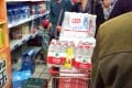 Lanzhou residents rush to supermarkets to buy bottled water after local tap water was found to contain high levels of benzene on Friday. Photo: SCMP Pictures