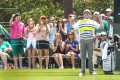 Bubba Watson plays the joker after a cracking tee-shot on the 16th hole set up another birdie. Photo: Reuters