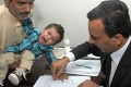A Pakistani lawyer takes a thumbprint from nine-month-old toddler Musa Khan. Photo: AFP