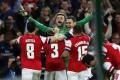 Arsenal goalkeeper Lukasz Fabianski celebrates with teammates after the penalty shoot-out win. Photo: Xinhua
