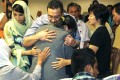 Malaysian Defence Minister and acting Transport Minister Hishamuddin Hussin hugs a family member of a missing Malaysian Airlines flight MH370 during his visit in Putrajaya on March 29, 2014. Photo: EPA