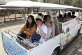 Chinese tourists ride on a cart while touring Chiang Mai University. Photo: AP
