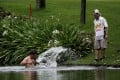 Pablo Larrazabal cools off in a lake after his hornet horror at the Malaysian Open. Photo: AP