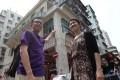 Haider Kikabhoy, founder of Walk In Hong Kong, and Olivia Tang show a tenement block in Sham Shui Po. Photo: Edward Wong