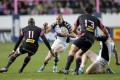 Full-back Mike Brown (centre) scored a key try for Harlequins with only 10 minutes to go against Leicester. Photo: AP