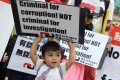 A one-year-old from Nepal attends yesterday's rally against the defamation lawsuit by ISS-HK. Photo: Dickson Lee