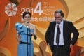 US director Oliver Stone laughs as Chinese actress Fan Bingbing speaks during the opening ceremony of the 4th Beijing International Film Festival in Beijing. Photo: Reuters