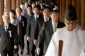 Japanese lawmakers led by a Shinto priest visit the Yasukuni Shrine in Tokyo on Tuesday. Photo: Reuters