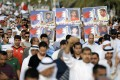 Protesters hold banners as they shout anti-government slogans and ask for releases of political prisoners during a protest in Budaiya west of Manama on April 4, 2014. Photo: Reuters