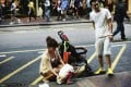 Hongkongers scuffled with the mainland couple after they allowed their toddler to relieve himself on a busy street in Mong Kok. Photo: SCMP Pictures