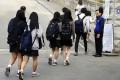 Senior students arrive at Danwon High School in Ansan, south of Seoul for the first time since its closure after the ferry Sewol sank. Photo: AP