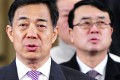 """Former Chongqing party boss Bo Xilai (left) and former police chief and deputy mayor Wang Lijun spearheaded a crackdown on organised crime. The campaign was lauded but also criticised for its use of """"illegal tactics"""". Photo: Reuters"""