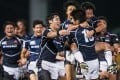 Japan's victorious under-20s players celebrate winning the 2014 Junior World Rugby Trophy at Hong Kong Football Club on April 19. Photo: HKRFU