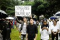 Singaporeans opposing a planned Philippine independence celebration.