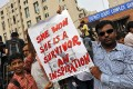 Demonstrators hold a placard outside a court in New Delhi after all four men convicted of raping and murdering a 23-year-old woman in New Delhi were sentenced to death. Photo: Reuters