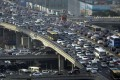 As the smog situation worsens in China's major cities, motorists are gasping for cleaner air. Photo: Reuters