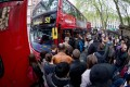 Commuters queue for buses outside Victoria railway station in central London amid the disruption caused by the Tube strike. Photo: AFP