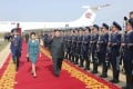 Kim Jong-un and his wife Ri Sol-ju walk past the guard of honour as they arrive for the 2014 Combat Flight Contest among commanding officers of the air force in this undated picture. Photo: Reuters