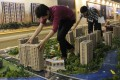 Hangzhou suffered a 15 per cent drop in prices of new homes from a year earlier. Photo: Reuters