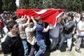 Mourners carry the coffin of a miner who died in the mine, draped with a Turkish flag. Photo: Reuters