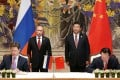 Gazprom CEO Aleksey Miller (left) and Zhou Jiping (right), head of China National Petroleum Corporation, ink the deal as Vladimir Putin and Xi Jinping look on. Photo: Xinhua
