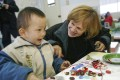 Jenny Bowen with a child at the Little Sisters Preschool in Anhui. Photos: Half the Sky Foundation