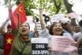 As Vietnamese protest against China's actions in disputed waters, today's workers may become tomorrow's jobless.Photo: EPA