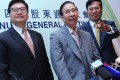Towngas managing director Alfred Chan (left), chairman Lee Shau-kee and chief executive Peter Wong. Photo: May Tse