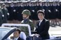Prime Minister Shinzo Abe reviews members of Japan's Self-Defense Force (SDF) at Asaka Base, north of Tokyo, in September 2013. Photo: AP