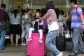 Mainlanders' spending in HK has no effect on our GDP