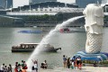 Tourists visit Merlion park in Singapore. Singapore is mounting a major tourism marketing drive in China. Photo: AFP
