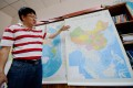 Lei Yixun, editor-in-chief of Hunan Map Press, shows the new vertical map of China. Photo: Xinhua