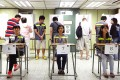 People vote in Hong Kong's unofficial referendum on democratic reform. Photo: AP